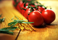 Tomato vine and pasta essential italian food ingredients shallow depth of field image of tomatoes rosemary herb dried selective Royalty Free Stock Photo