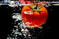 Tomato water splash Royalty Free Stock Image