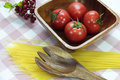 Tomato on wood plate Stock Image