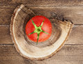 Tomato on wooden background brown Royalty Free Stock Photos
