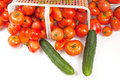 Tomatoe Basket with Dill and Cucumbers Stock Photos