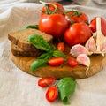 Tomatoes with basil and garlic Royalty Free Stock Photo