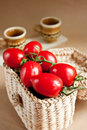 Tomatoes in a basket Stock Photo