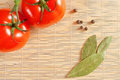 Tomatoes and bay leaf Royalty Free Stock Photo