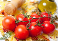 Tomatoes on a branch, pasta and spices Royalty Free Stock Image