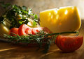 Tomatoes, cheese and greens Royalty Free Stock Photos