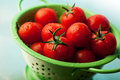 Tomatoes in colander Stock Photo