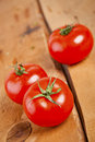 Tomatoes cooked with herbs for the preservation on the old wooden table Stock Photo