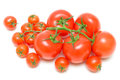 Tomatoes of different sizes on a white background Royalty Free Stock Photography