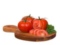 Tomatoes ensemble sliced on wooden plank Stock Photo