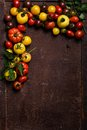 Tomatoes frame on a rusty background Royalty Free Stock Photo