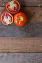 Tomatoes fresh red sliced on a wooden board Royalty Free Stock Image
