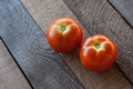 Tomatoes fresh red on a wooden board Royalty Free Stock Image
