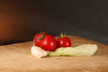 Tomatoes Garlic and Lettuce on Wood surface. Royalty Free Stock Photo
