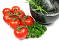 Tomatoes, herbs and mortar Stock Photography