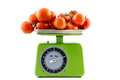 Tomatoes on a kitchen scale green vintage with it Stock Photography