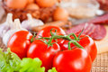 Tomatoes and other foods Stock Photo
