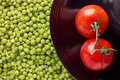 Tomatoes and Peas Royalty Free Stock Images