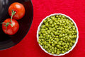 Tomatoes and Peas Stock Image