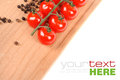 Tomatoes and peppers on wooden board Royalty Free Stock Image