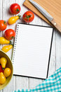Tomatoes with recipe book blank Royalty Free Stock Photo