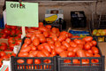 Tomatoes for sale on market boxes of freshly harvested organic red a Stock Images
