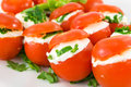 Tomatoes stuffed with cheese Stock Images