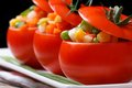 Tomatoes stuffed with fresh vegetables horizontal. low key Royalty Free Stock Photo