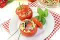 Tomatoes stuffed with pasta salad and cress on a light background Royalty Free Stock Photos