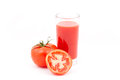 Tomatoes and tomato juice. Royalty Free Stock Photography