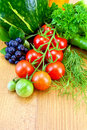 Tomatoes and vegetables on the board Royalty Free Stock Photography