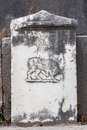 A tomb with an animal bas relief in delphi greece Stock Images