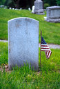 Tombstone and american flag Royalty Free Stock Images