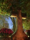 Tombstone cross old in night glow Stock Photos