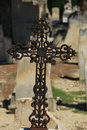 Tombstone with cross ornament at a french cemetery gravestone Royalty Free Stock Images