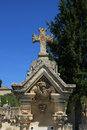 Tombstone with cross ornament at a french cemetery gravestone Royalty Free Stock Photos