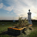 Tombstone memorial in rural cemetary. Stock Photography