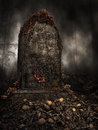 Tombstone on a pile of skulls old with autumn ivy Stock Photos