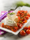 Tomino cheese pachino tomatoes salad selective focus Stock Image