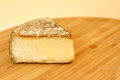 Tomme de savoie cheese on wooden board Royalty Free Stock Photos