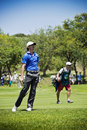 Tommy fleetwood clubbing the ball up the fairway heading to the green on the th day of the tournament sun city gary player golf Stock Photos