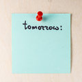 Tomorrow note on paper post it Royalty Free Stock Photo