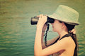 Toned image teen girl looking through binoculars side view horizontal Royalty Free Stock Photos