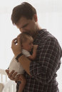 Toned portrait of happy father holding newborn baby against wind Royalty Free Stock Photo