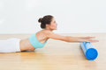 Toned woman doing stretching exercise in fitness studio side view of a young the Royalty Free Stock Image