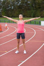Toned woman doing stretching exercise on the running track full length of a young Royalty Free Stock Photos