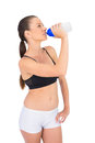 Toned woman in sportswear drinking water on white background Royalty Free Stock Images