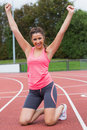 Toned young woman cheering on the running track Royalty Free Stock Photos