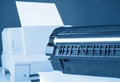 Toner cartridge against laser printer toned in blue Royalty Free Stock Photos