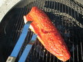 Tongs with Copper River Salmon Stock Photography